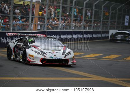 KUALA LUMPUR, MALAYSIA - AUGUST 08, 2015: Sam Lok drives a Lamborghini Huracan Super Trofeo LP620 car on the city streets in the KL City GT CUP Race of the 2015 Kuala Lumpur City Grand Prix.