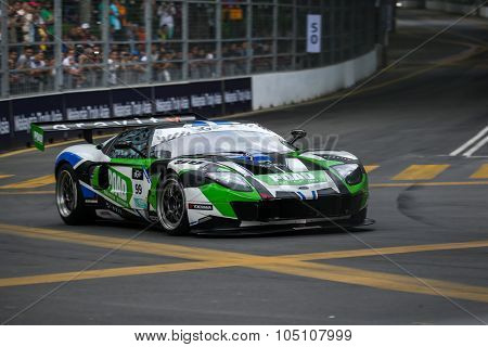 KUALA LUMPUR, MALAYSIA - AUGUST 08, 2015: Frank Yu drives a Ford GT3 car takes turn 2 in the KL City GT CUP Race of the 2015 Kuala Lumpur City Grand Prix.