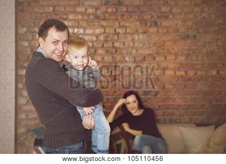 Happy Young Father, Mother And Cute Baby Girl