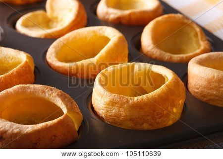 Yorkshire Puddings In Baking Dish Macro. Horizontal