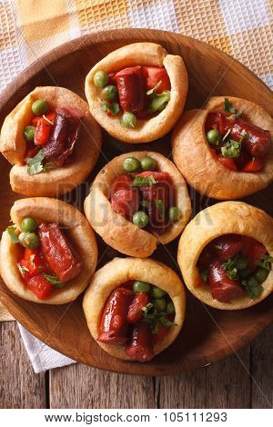 Yorkshire Puddings With Sausage And Vegetables Closeup Vertical Top View