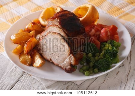 Sunday Roast: Pork With Vegetables And Yorkshire Pudding Closeup.