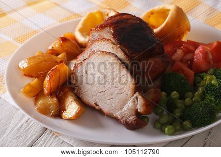 Baked Pork With Potatoes, Fresh Vegetables And Yorkshire Pudding
