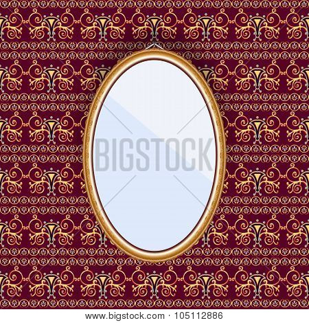 Oval Mirror In A Frame On The Wall With Patterned Wallpaper.