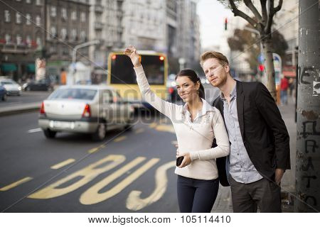 Young People Waiting Bus On The Street