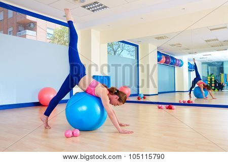Pilates woman fitball arabesque exercise workout at gym indoor