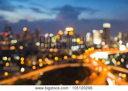 Abstract blurred bokeh highway intersection with city downtown lights background