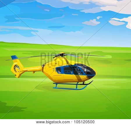 Yellow helicopter on green field