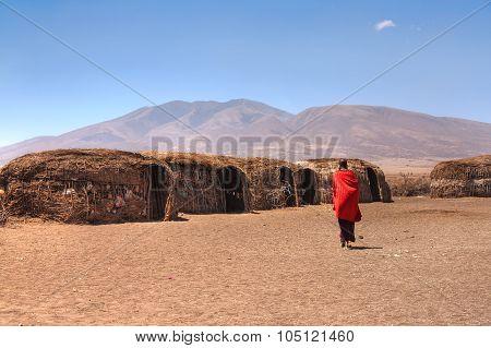 Massai huts and Massai woman
