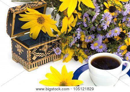 Casket, Cup Of Coffee, Bouquet Of Wild Flowers And Yellow Flower, The Isolated Image