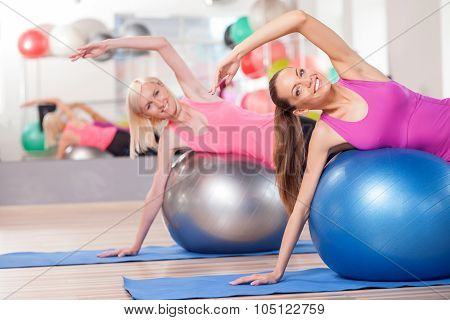 Attractive young women are exercising in gym