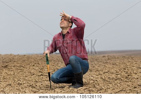 Farmer Waiting For Rain