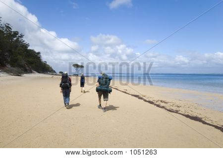 Three Hikers On Ocean Beach