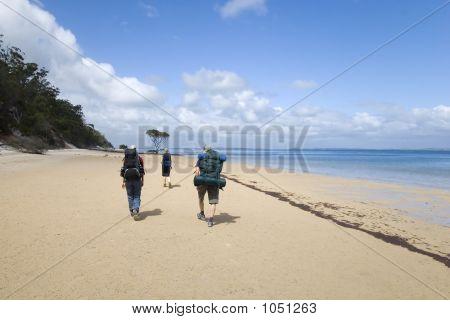 Three Hikers On Ocean Beach