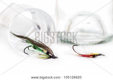 Fly Fishing Bait With Glass And Bottle Alcohol