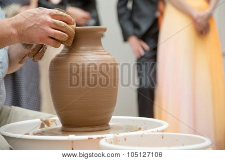 Potter Working On Ceramic Jug