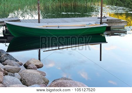 Rowboat Near Wooden Jetty