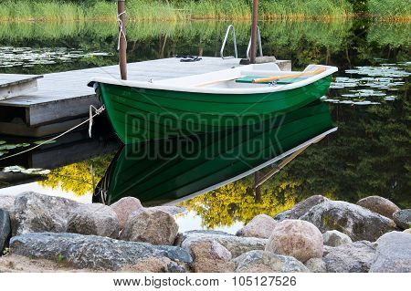 Green Rowboat Near Dommy