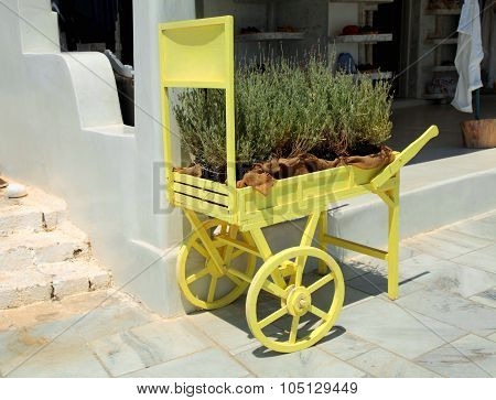 Decorative Old Cart With Flowers On The Street In Oia, Santorini, Greece.