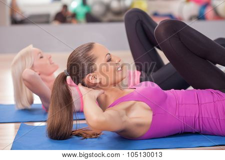 Beautiful young women are training in fitness center