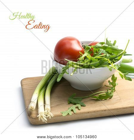Ingredients For Tomato Salad Or Tomato Soup With Rocket And Spring Onions, Isolated On White