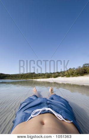 Man Lying In Lake