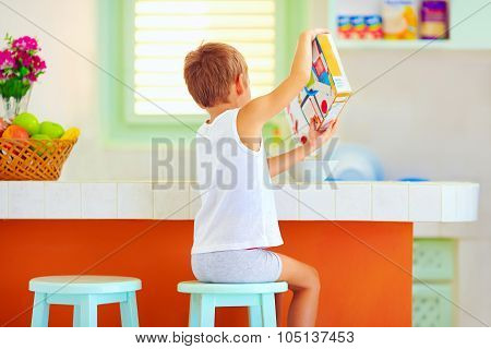 Unaided Little Boy Preparing Breakfast In The Morning At Home