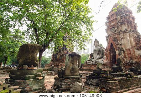 Old buddha pagoda with damaged Buddha
