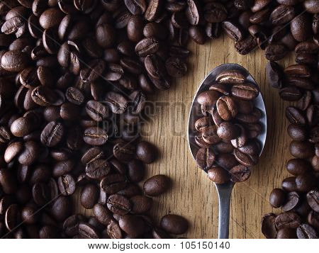 Coffee beans and a spoon with coffee beans