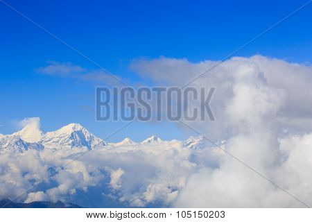 Spectacular snow mountain scenery and rolling clouds