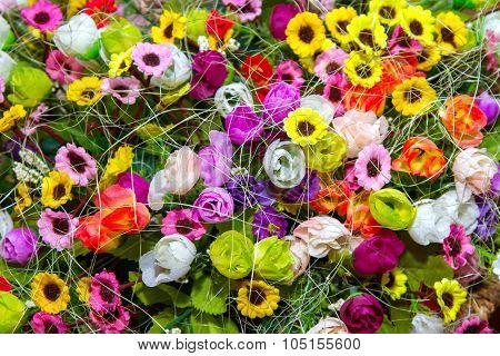 Background Colorful Multicolored Small Artificial Flowers In A Basket