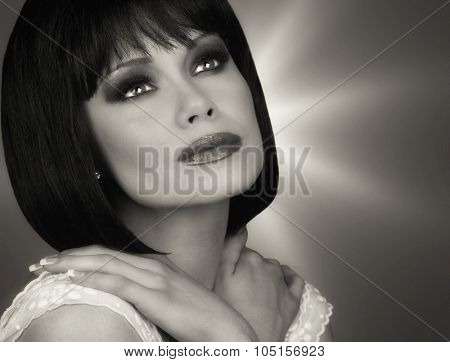 Beautiful Image of a brunette Glamour Model On Grey