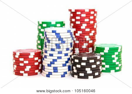 Stacks Of Poker Chips Including Red, Black, White And Green On A White Background