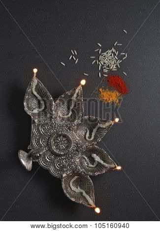 Antique Indian lamp and kumkum. Hindu religious objects.