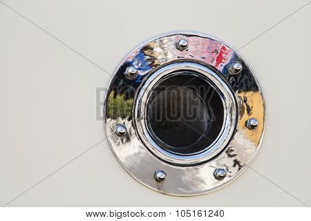 Porthole with reflections of colors