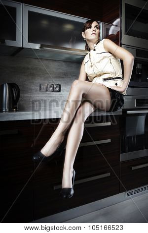 Pretty Brunete In Kitchen