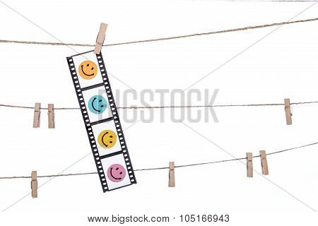 Hanging Photographic Negatives With Smiley Face,  Comedy Happy Life