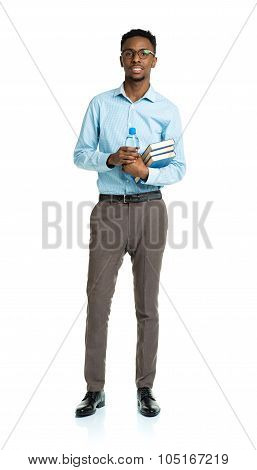Happy African American College Student With Books And Bottle Of Water In His Hands