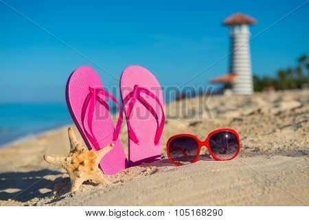 Women's Marine Accessories: Sandals, Sunglasses And Starfish On Tropical Sand Beach Against The Back