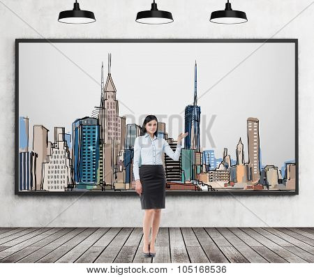 A Brunette Lady Is Pointing Out The Picture Of New York City On The Wall. Wooden Floor, Concrete Wal