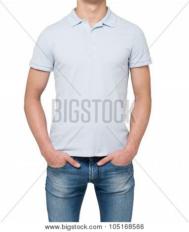 Man Wearing Light Blue Polo Shirt And Denims. Hands Are In The Pockets. Isolated On White Background