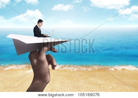 Business Man Typing With Laptop On The Paper Plane