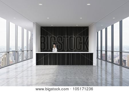 A Reception Area In A Modern Bright Clean Office With A Beautiful Receptionist In Formal Clothes. Hu