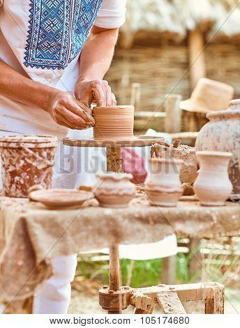 Ethnic art, skilled master creating pot of clay, ceramic, craft