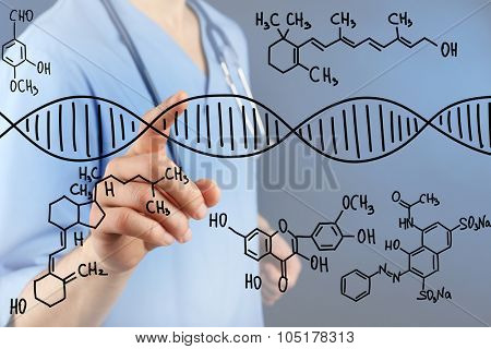 Young doctor working with drawing DNA molecule