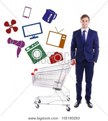 Young man holding empty shopping cart with different icons, isolated on white