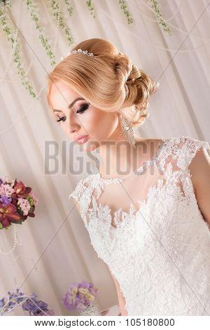 Portrait of Beautiful Bride. Beautiful bride in a wedding-dress is in fashion style. Wedding decorat