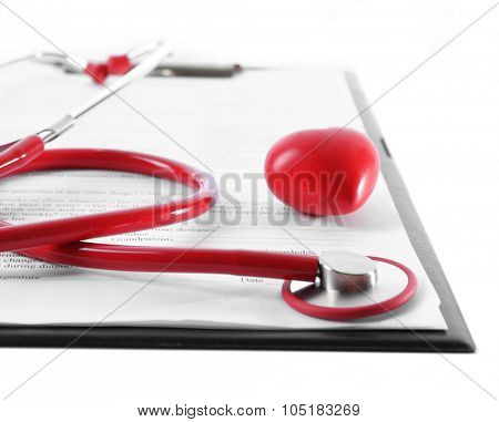 red rubber stethoscope with plastic heart and medical history isolated on white