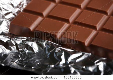 Chocolate bar in foil, close-up
