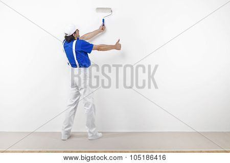Painter With Paintroller Doing Ok On White Wall
